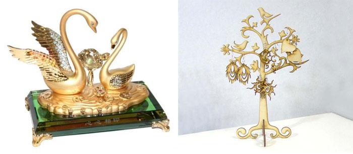 Золотые статуэтки лебеди и дерево